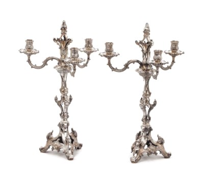 A pair of silver three-light c