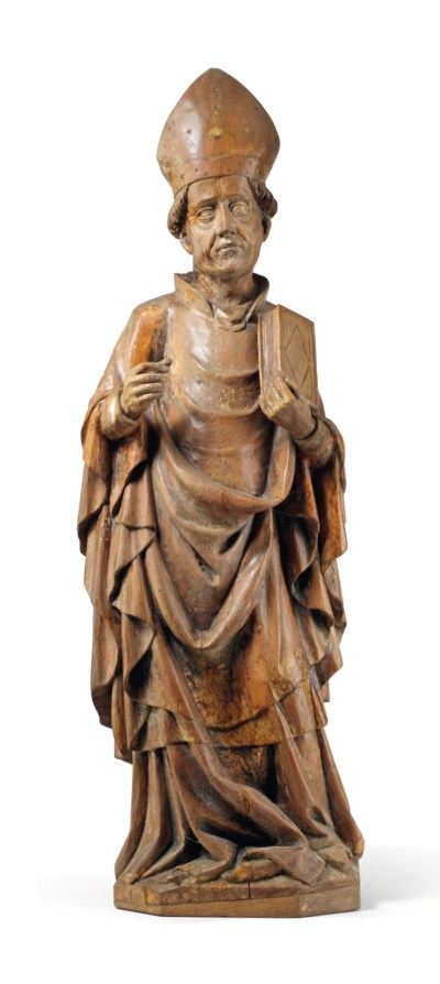 A CARVED PINE FIGURE OF A BISS