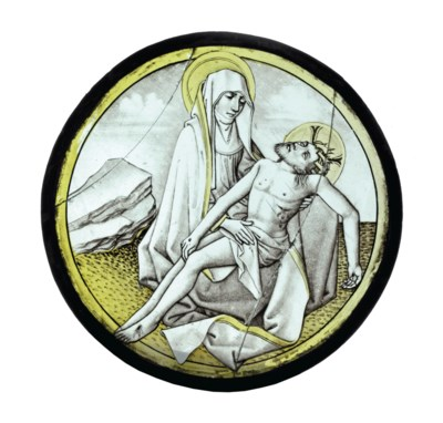 A STAINED GLASS ROUNDEL DEPICT