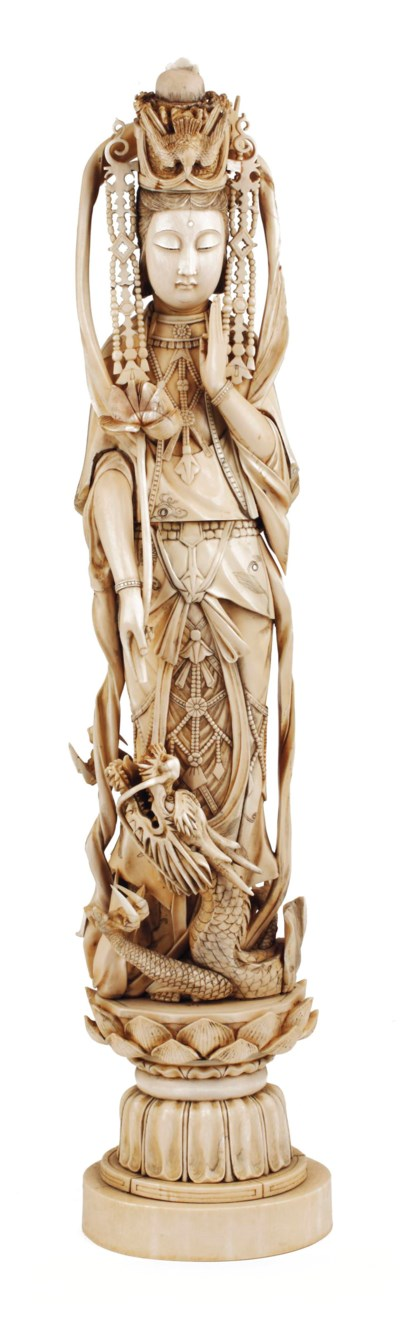A Chinese ivory figure of Guan
