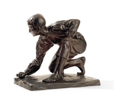 A BRONZE FIGURE OF A YOUNG BOY