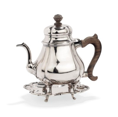 A Dutch silver teapot and cove