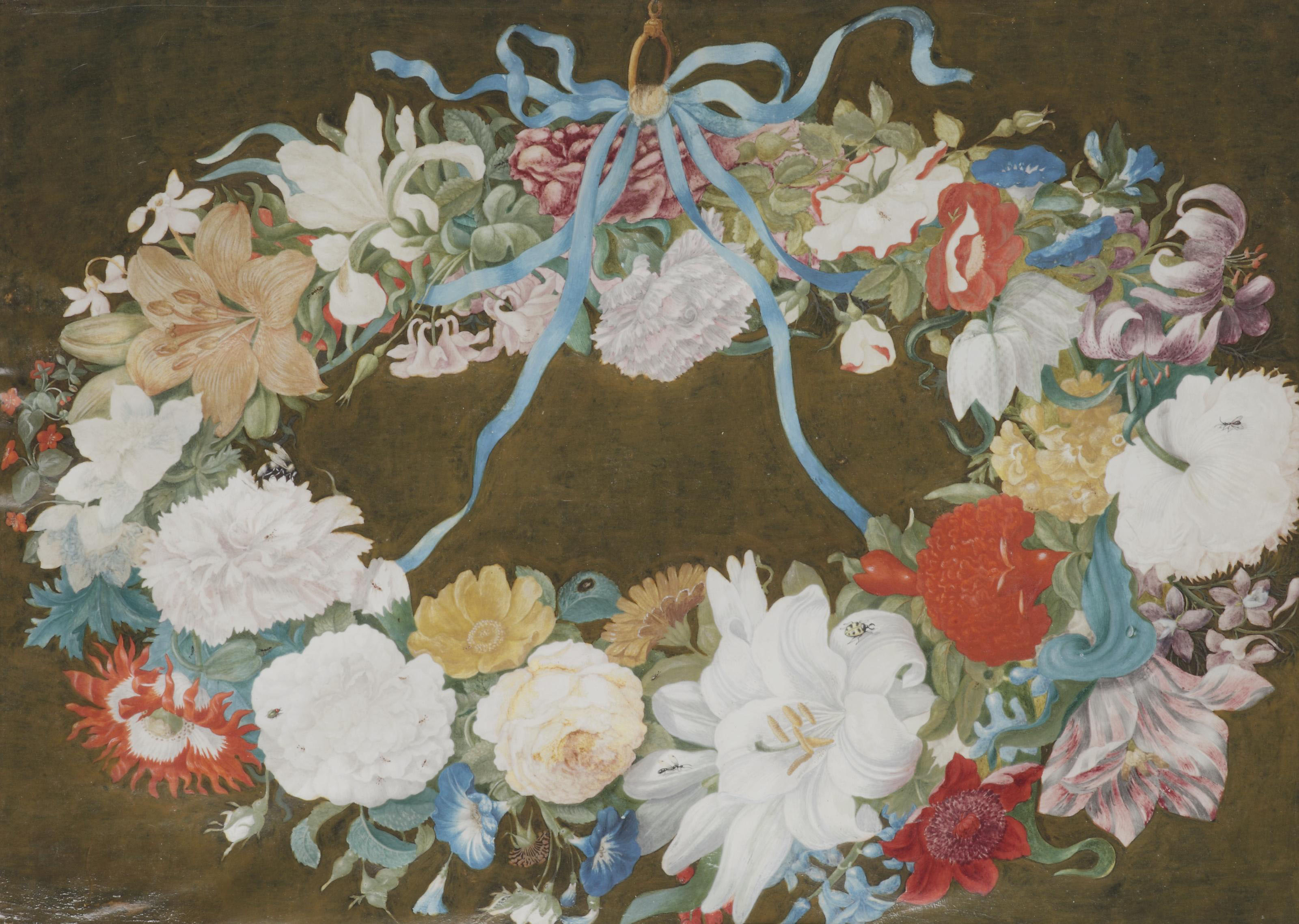 A flower garland with a blue ribbon