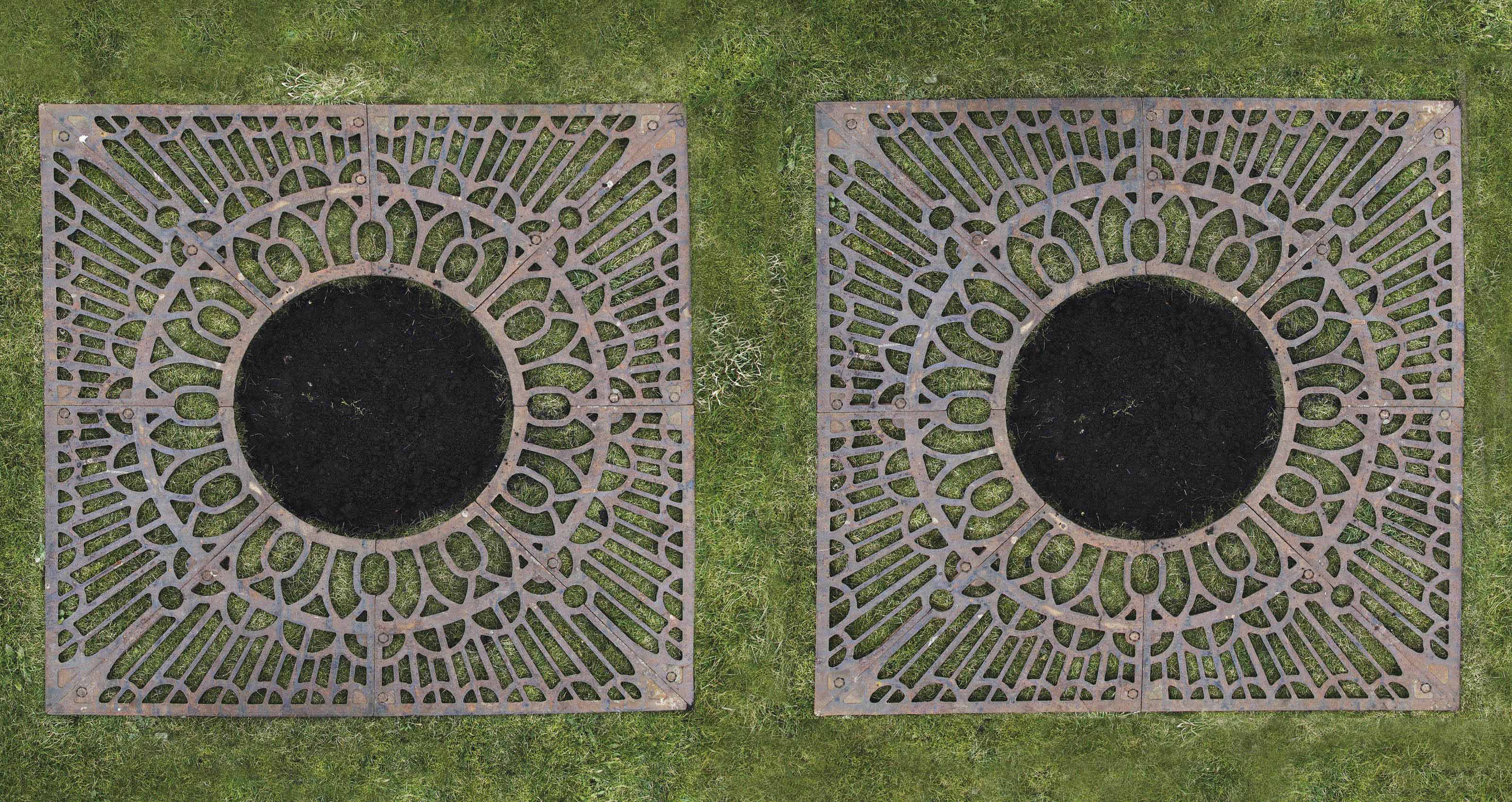 A pair of cast-iron tree grilles