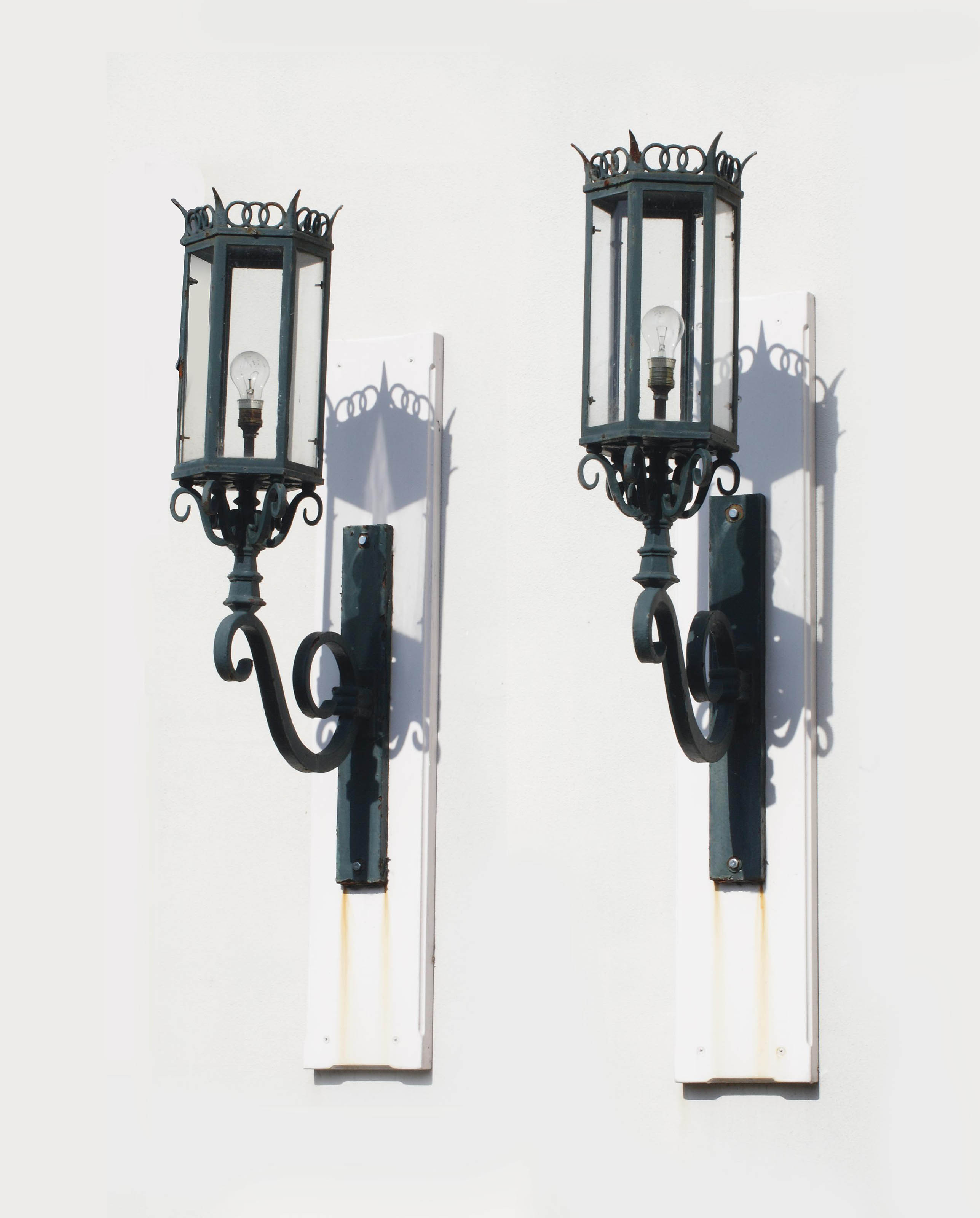 A pair of wrought-iron wall lanterns