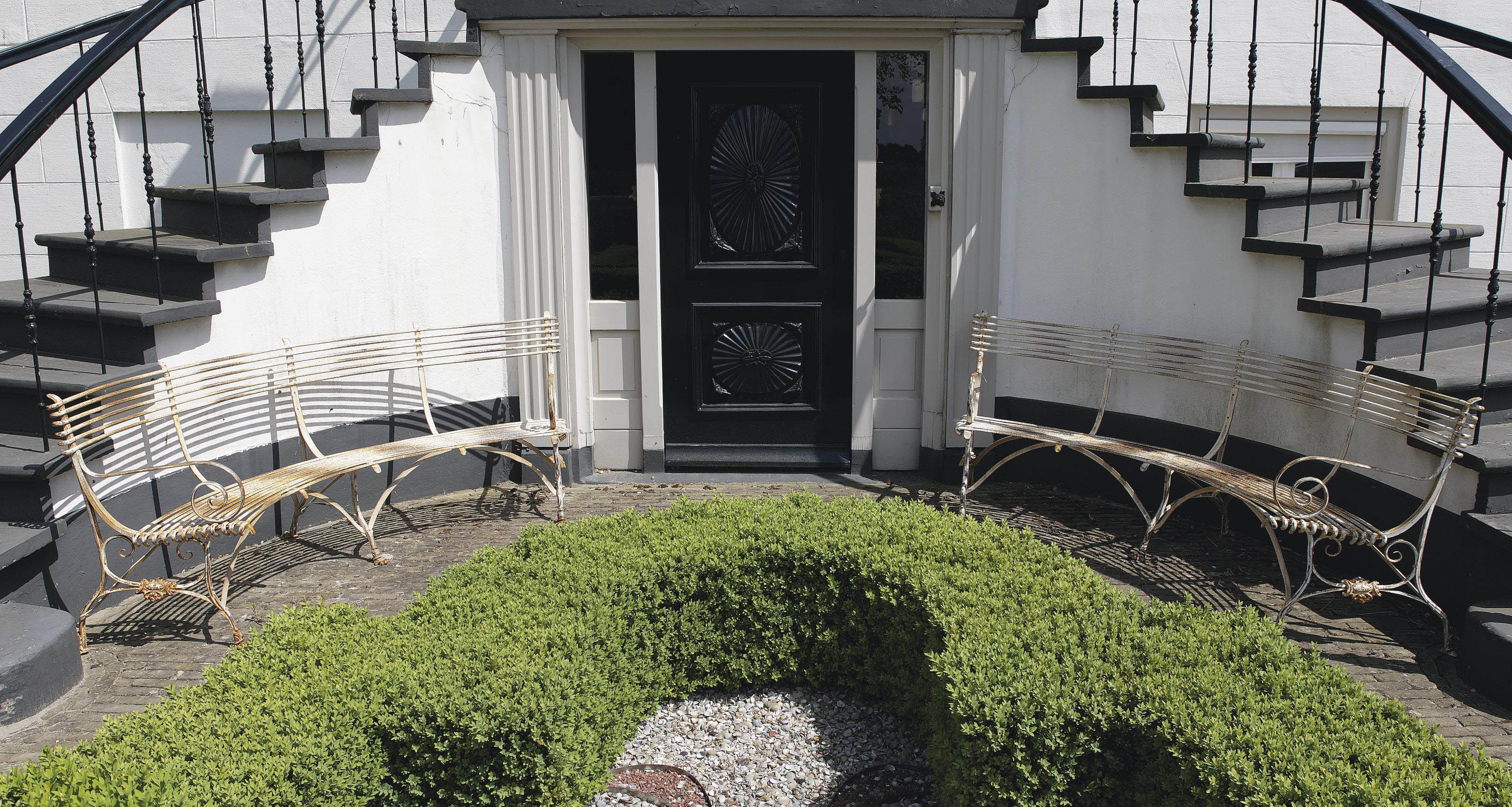 A pair of French white painted cast- and wrought-iron circular garden benches