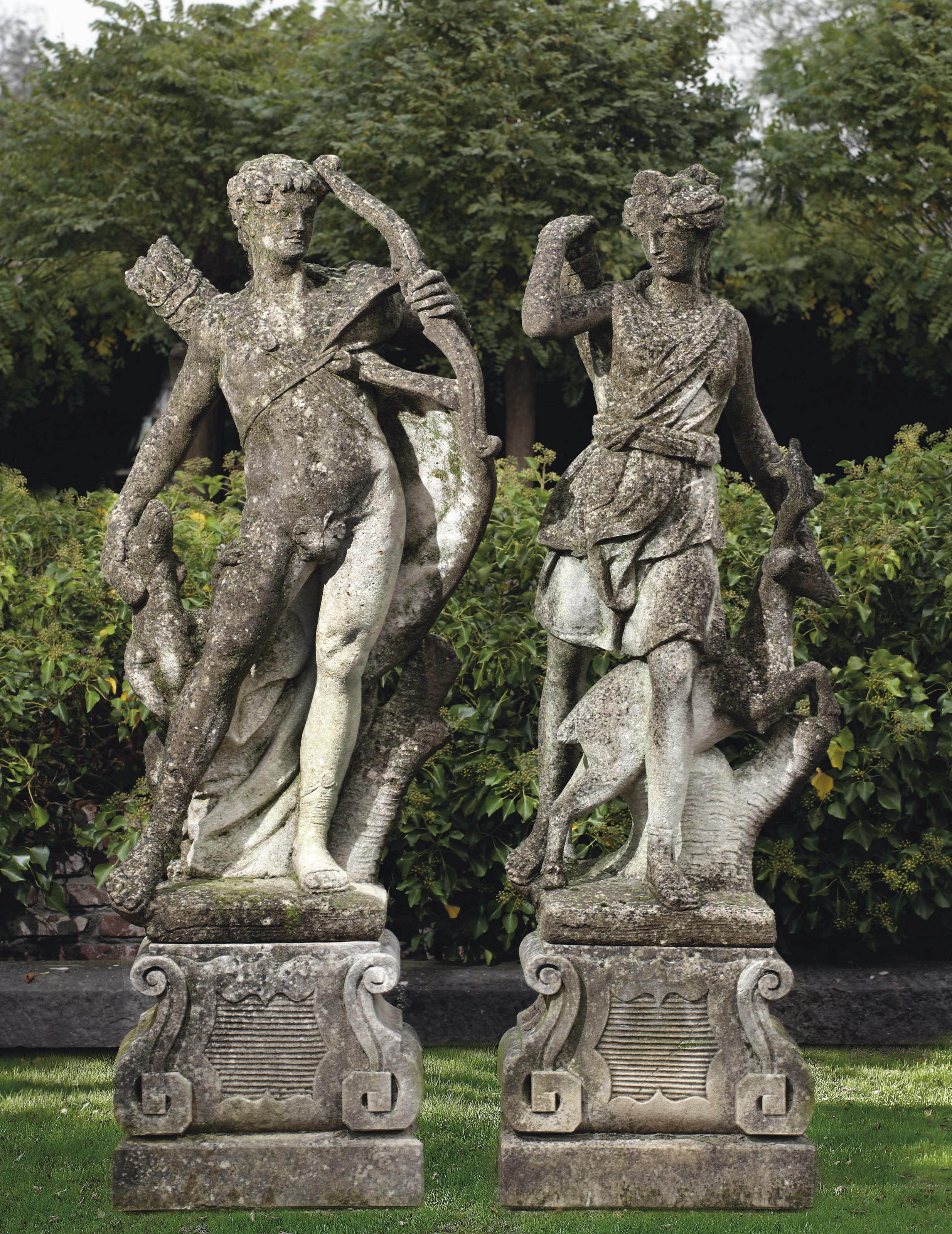 A pair of carved limestone figures of Diana and Apollo