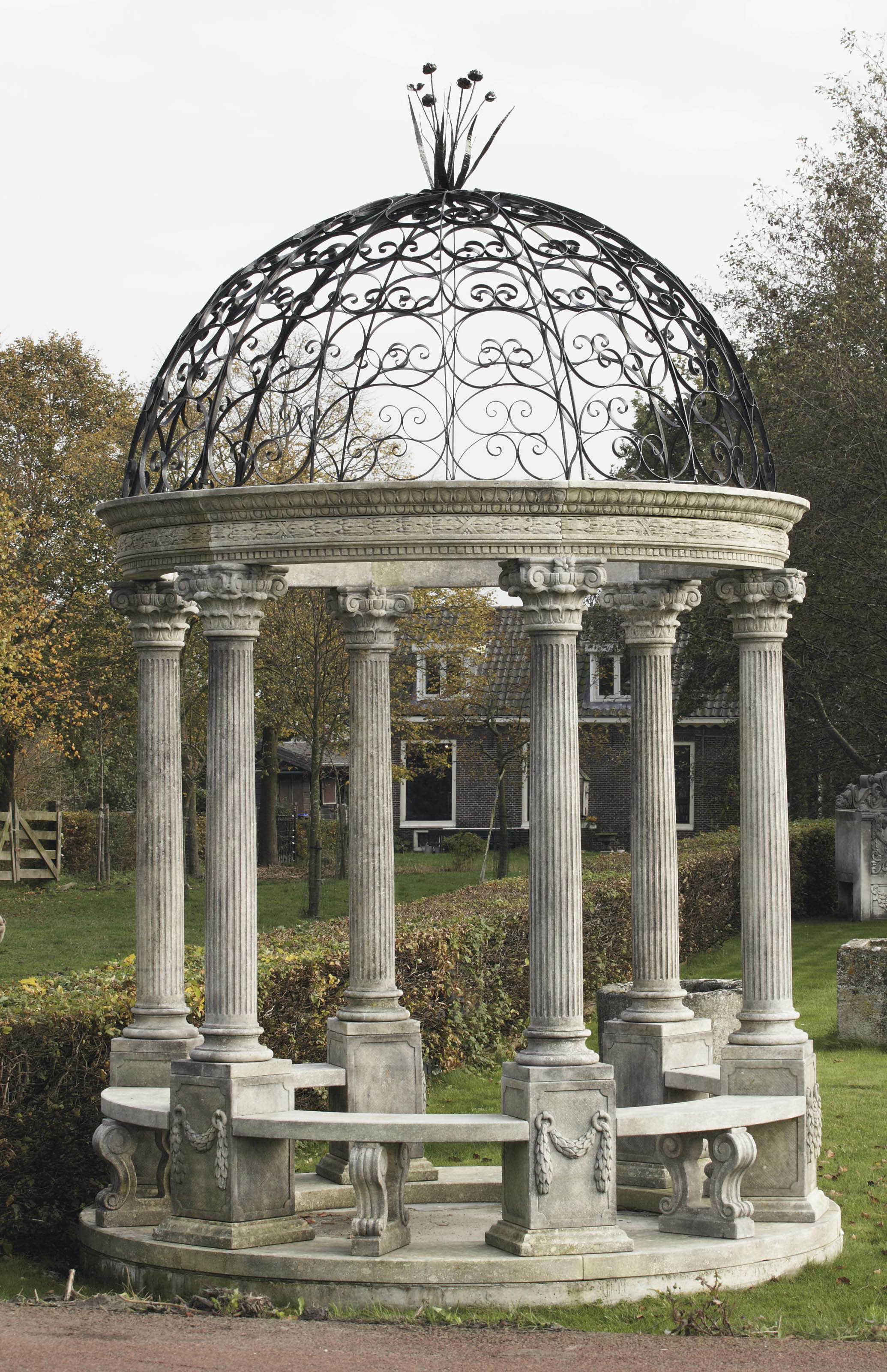 A carved limestone and wrought-iron Rotunda