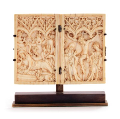 A carved ivory dyptich depicti