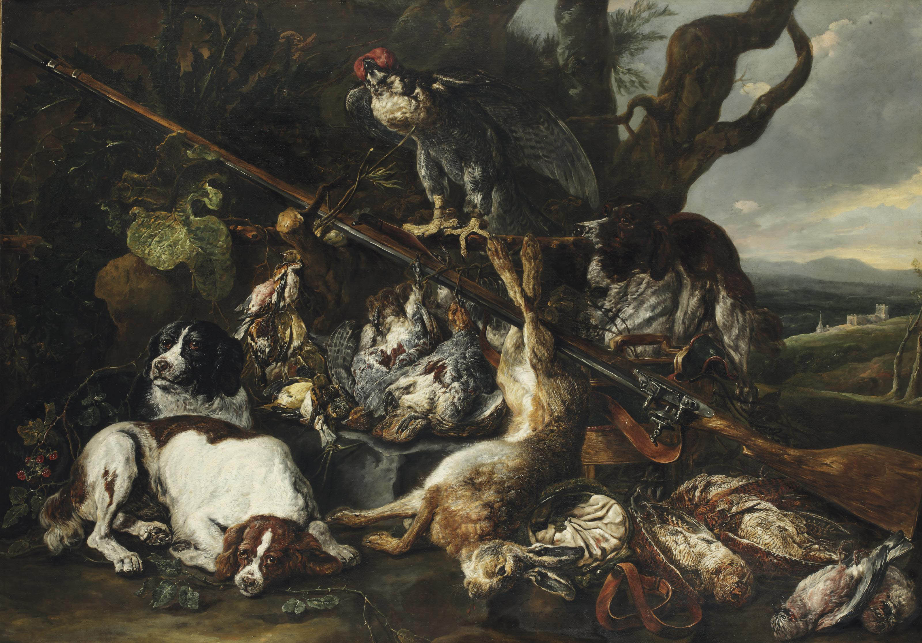 A hunting still life of a hare, partridges, snipes and other birds, together with three spaniels, a hooded falcon, a rifle and a game-bag and belt in a hilly landscape