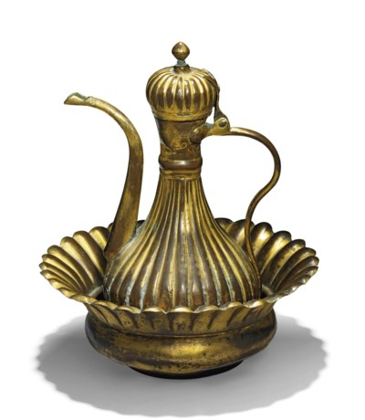 A GILT-COPPER EWER AND BASIN