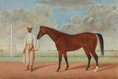 A BAY RACEHORSE AND GROOM