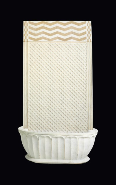 A CARVED AND INLAID WHITE MARB