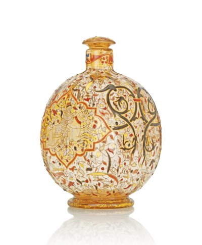 AN ENAMELLED GLASS BOTTLE AND