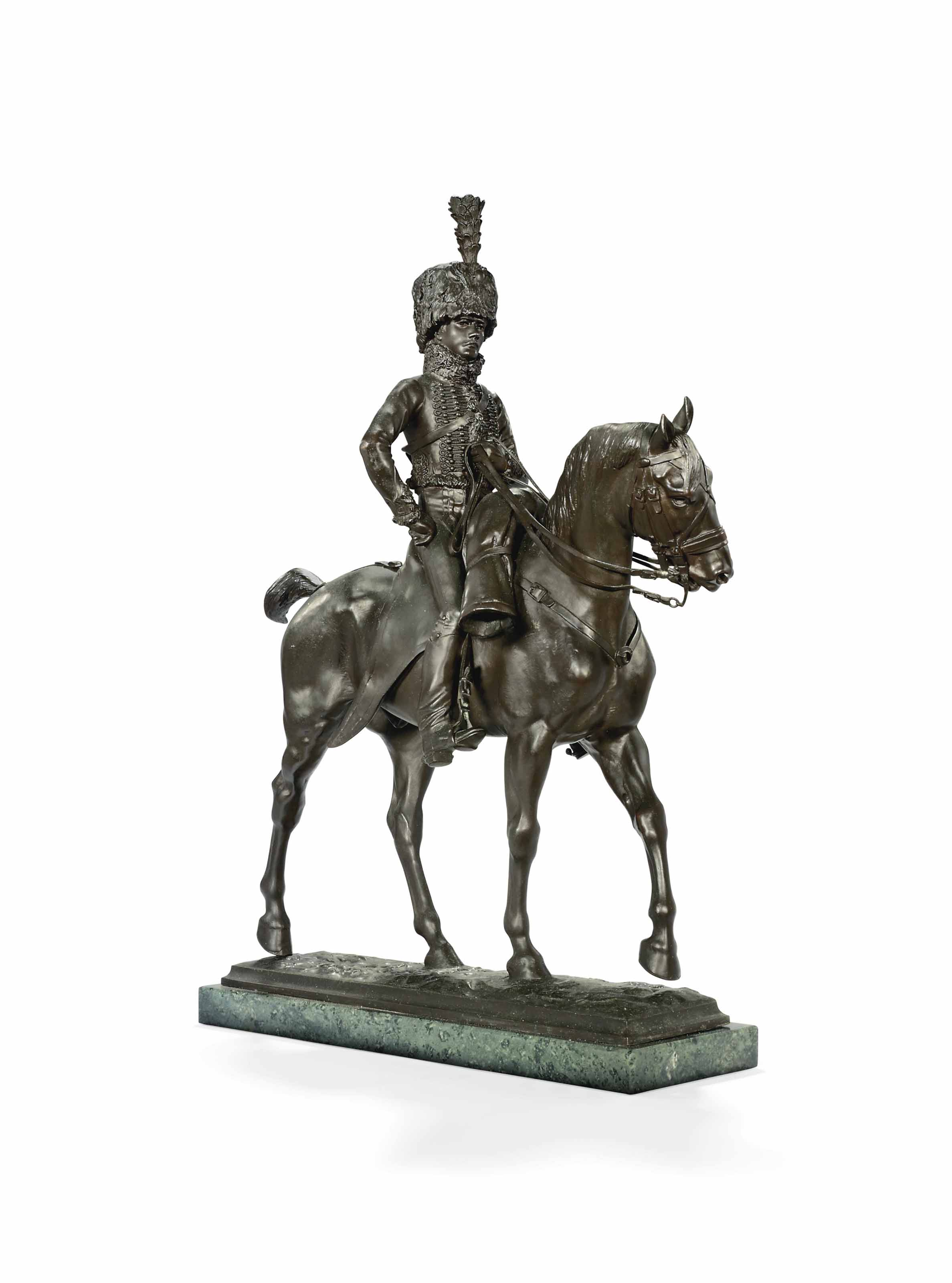 A BRONZE GROUP OF A HUSSAR ON HORSEBACK