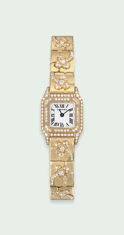 AN 18 CARAT GOLD AND DIAMOND L