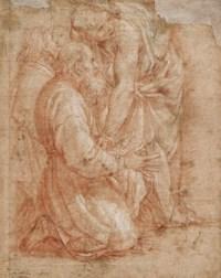 A young man attending an older kneeling man
