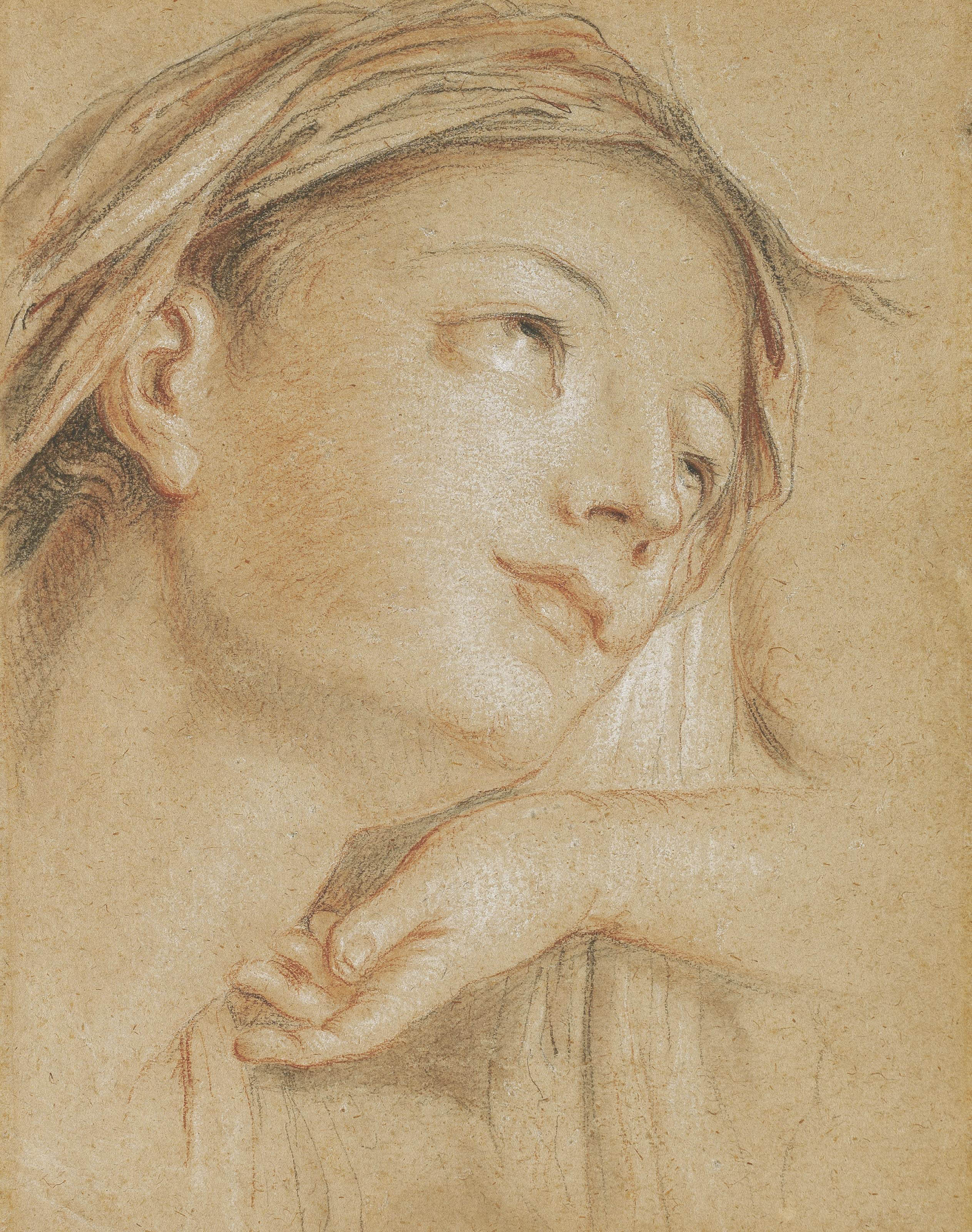 The head of the Virgin, looking up to the right, with a subsidiary study of a hand