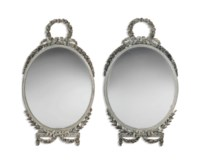 A PAIR OF GEORGE III SILVERED OVAL MIRRORS