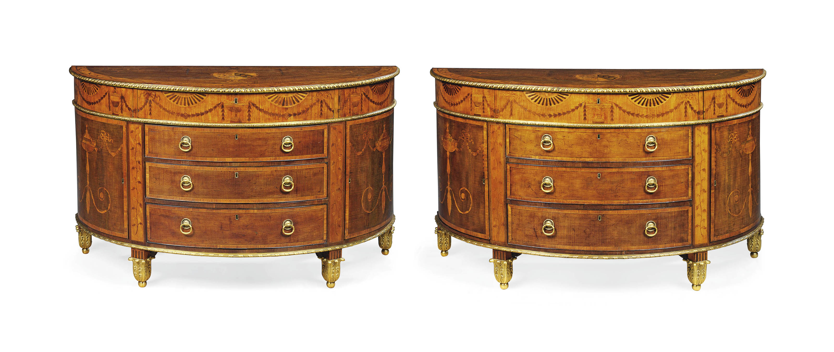 A PAIR OF GEORGE III ORMOLU-MOUNTED SYCAMORE, SATINWOOD AND MARQUETRY SEMI-ELLIPTICAL COMMODES