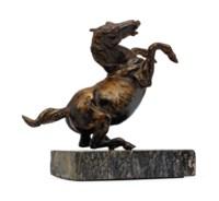 A BRONZE REARING HORSE