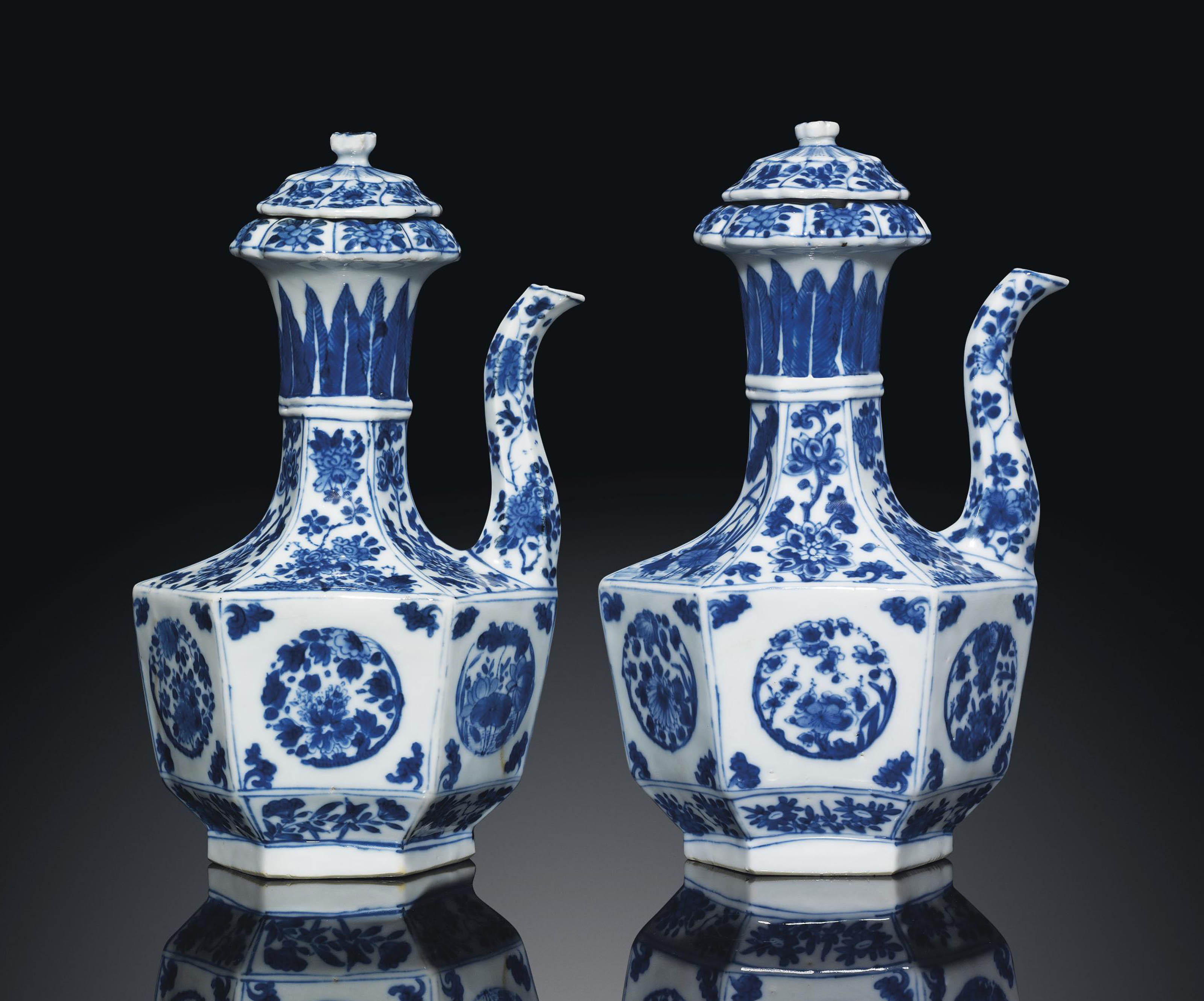 A PAIR OF BLUE AND WHITE HEXAGONAL EWERS AND COVERS