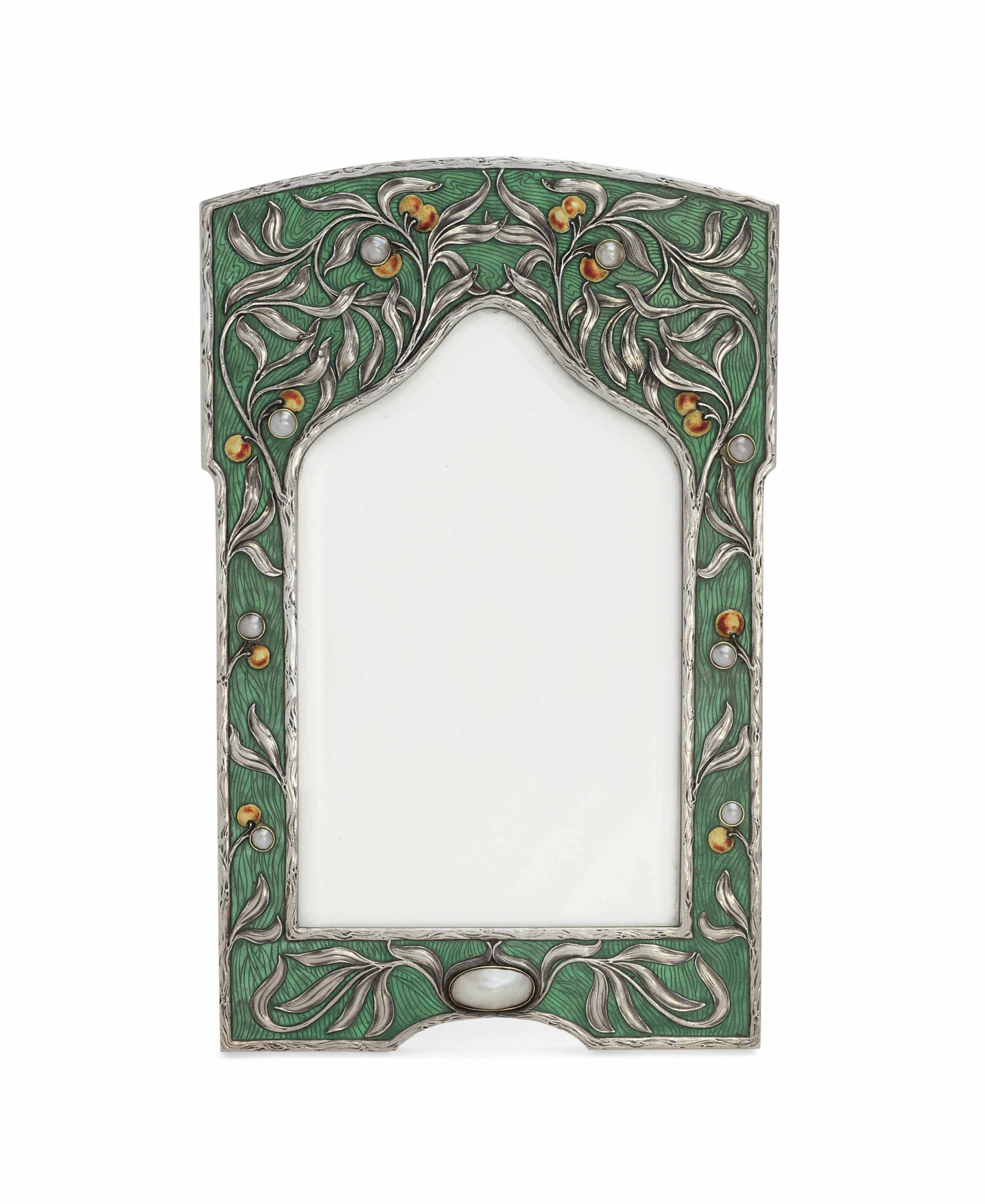 A JEWELLED SILVER-GILT AND CHAMPLEVÉ ENAMEL PHOTOGRAPH FRAME