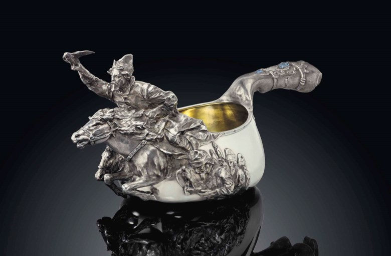 A highly important monumental gem-set parcel-gilt silver kovsh, marked K. Fabergé with the imperial warrant, Moscow, circa 1909, scratched inventory number 24682. 21 in (53.3 cm) wide, 125.28 oz (3896.5 gr) gross. Sold for £301,250 on 26 November 2012