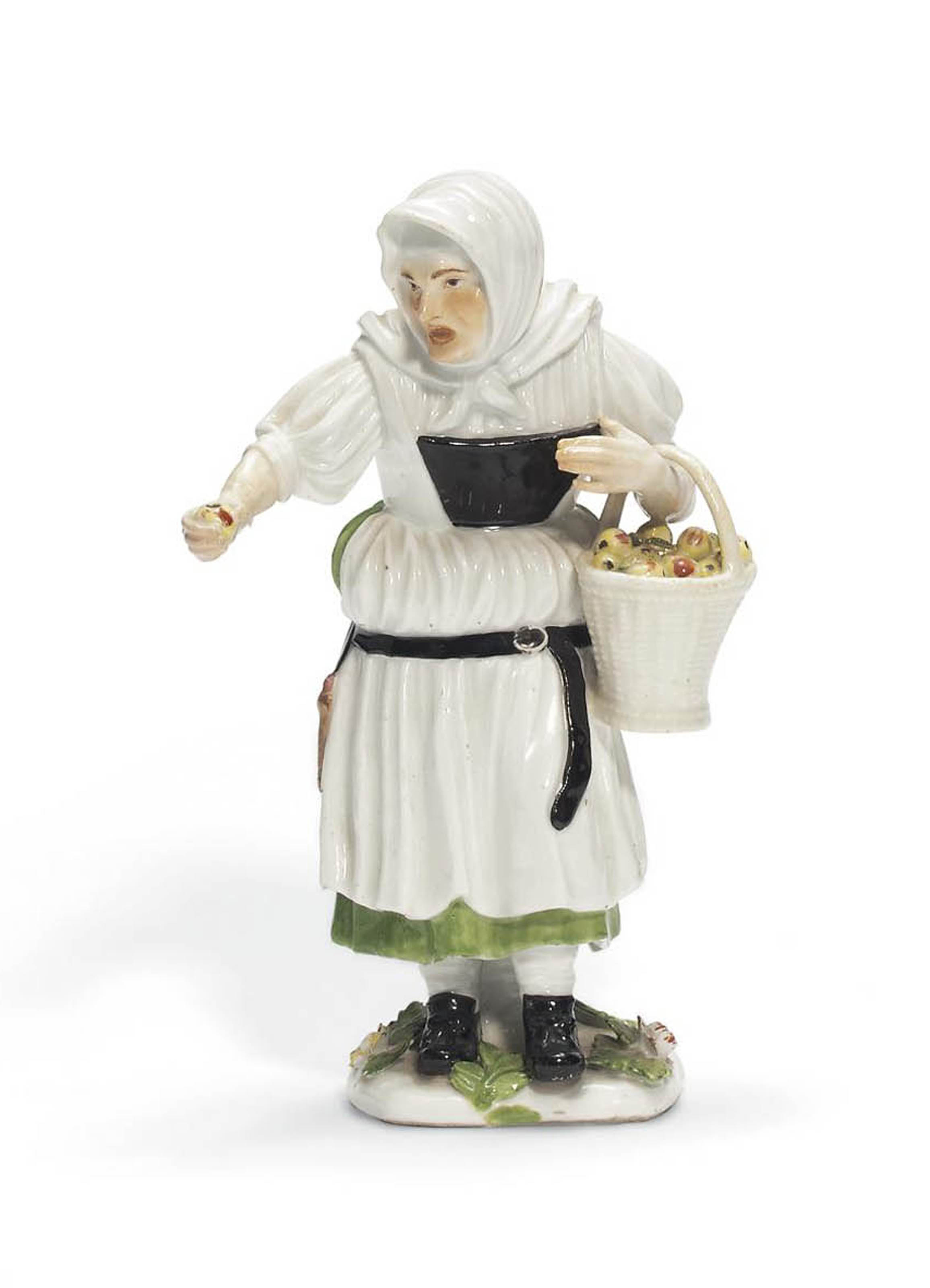 A MEISSEN FIGURE OF A FRUIT-SELLER FROM A SERIES OF PARISIAN STREET-TRADERS