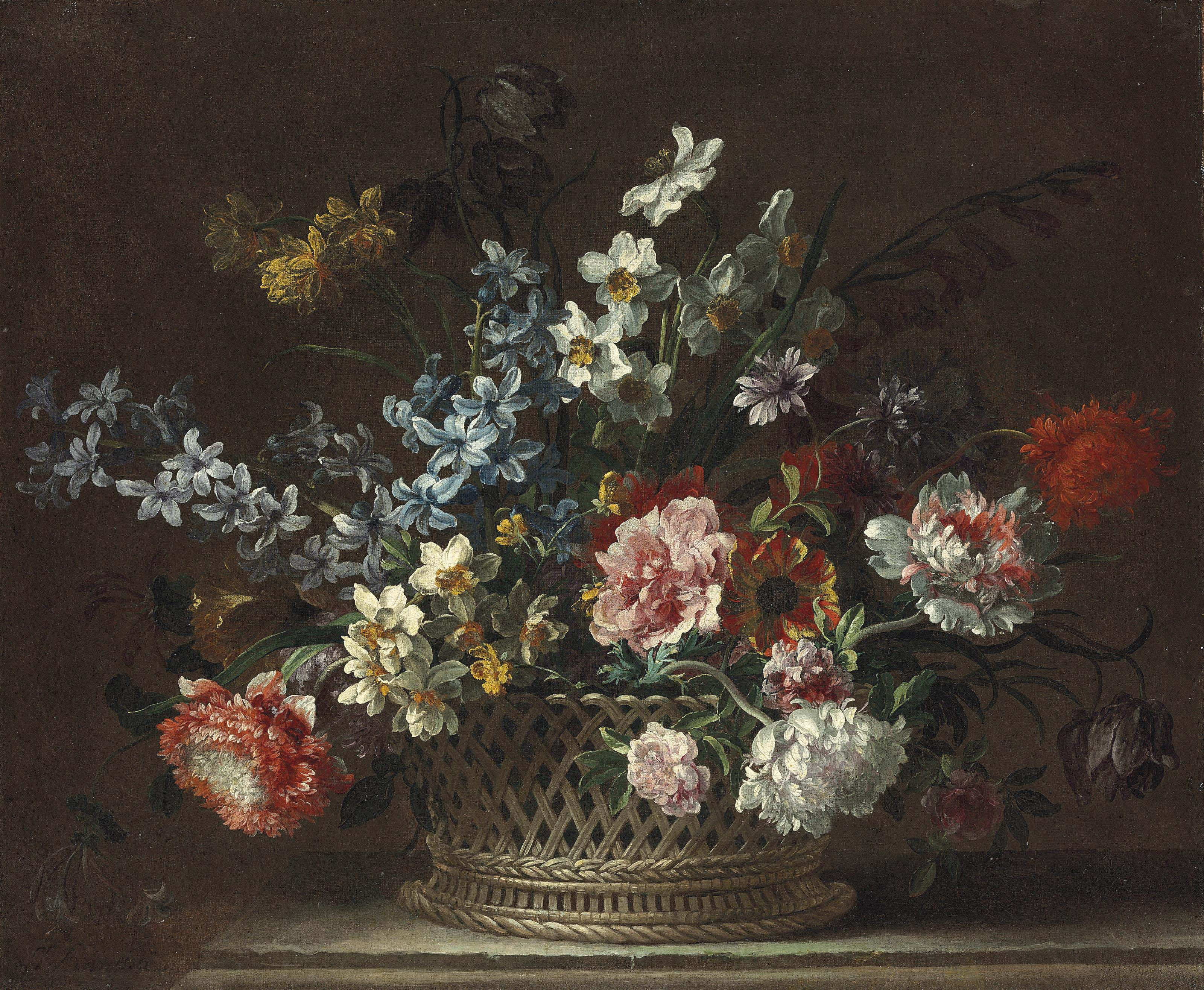 Roses, daffodils, hyacinths, anemones, fritillaries and other flowers in a woven basket on a stone ledge