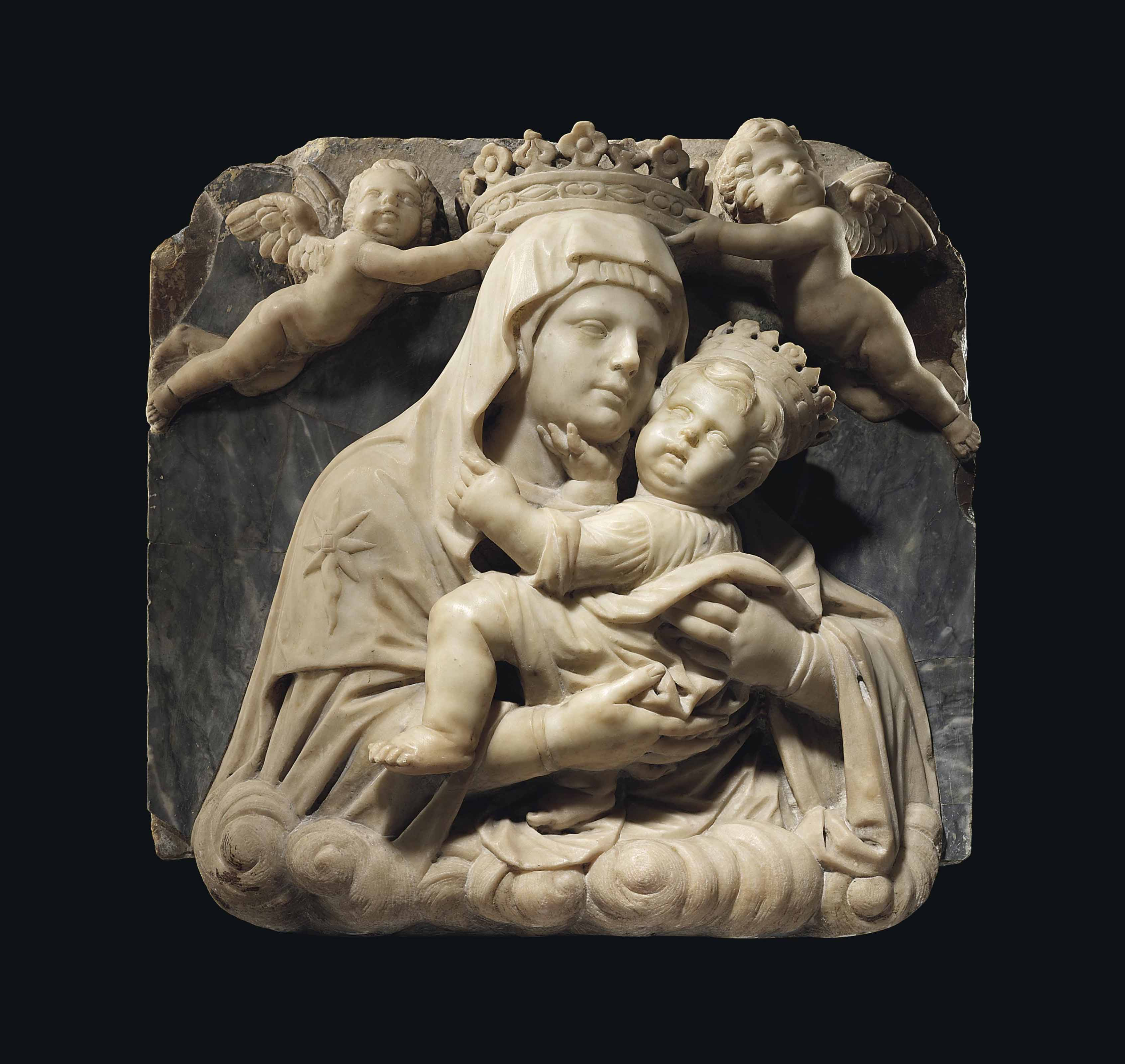 A square carved marble high relief of the virgin and child