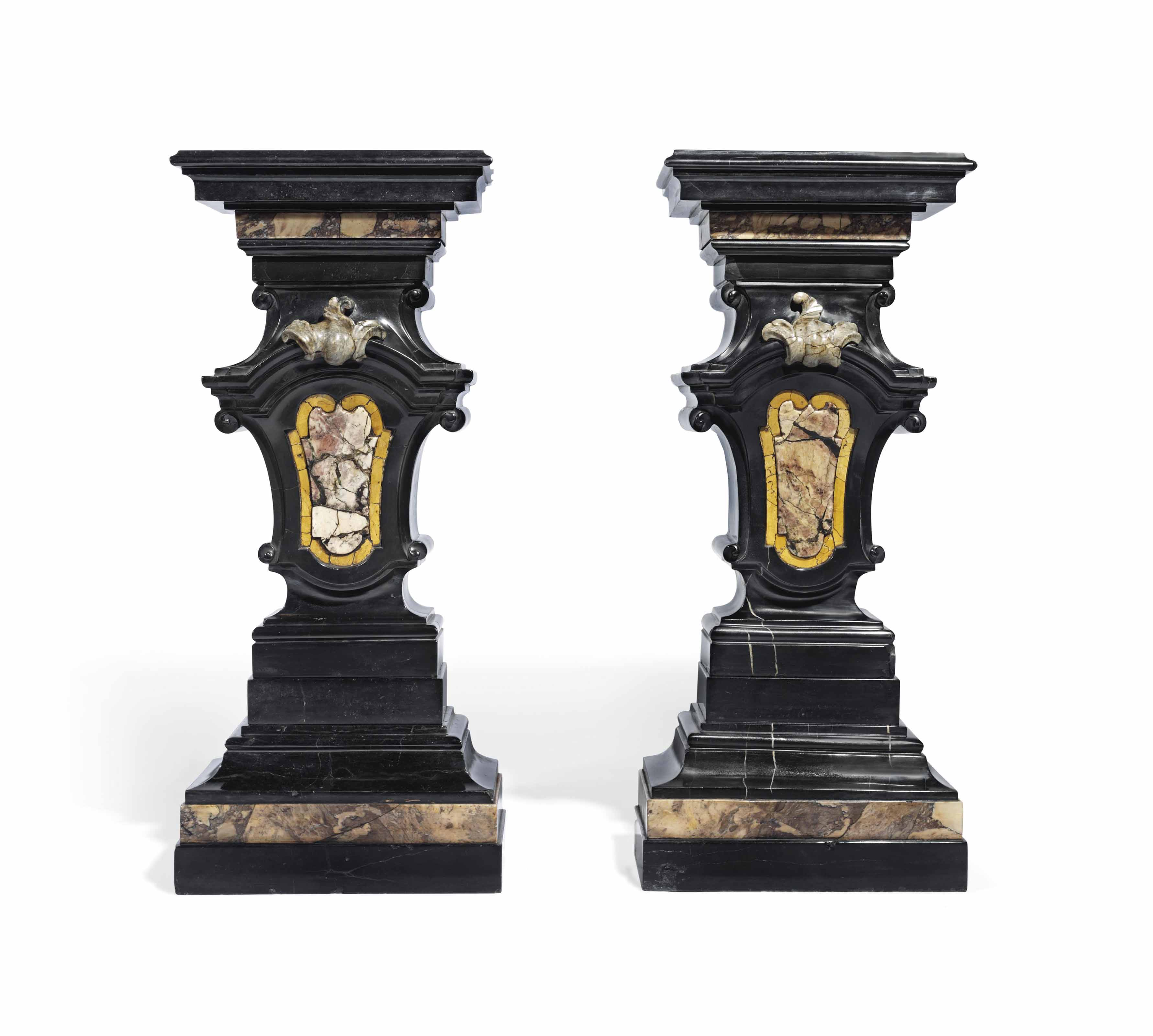 A PAIR OF BLACK MARBLE AND COLOURED MARBLE PEDESTALS
