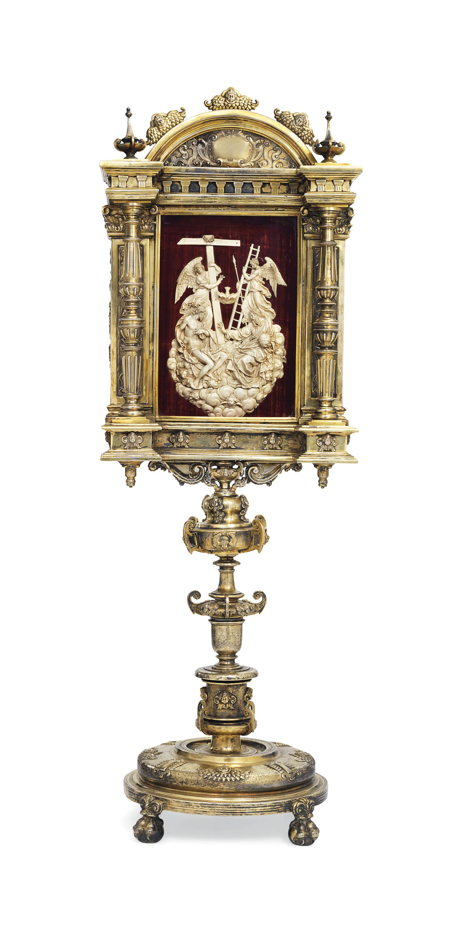 A SILVER-GILT FRAMED CARVED IVORY RELIEF OF THE HOLY TRINITY