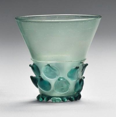 A GREEN GLASS BEAKER (BERKEMEY