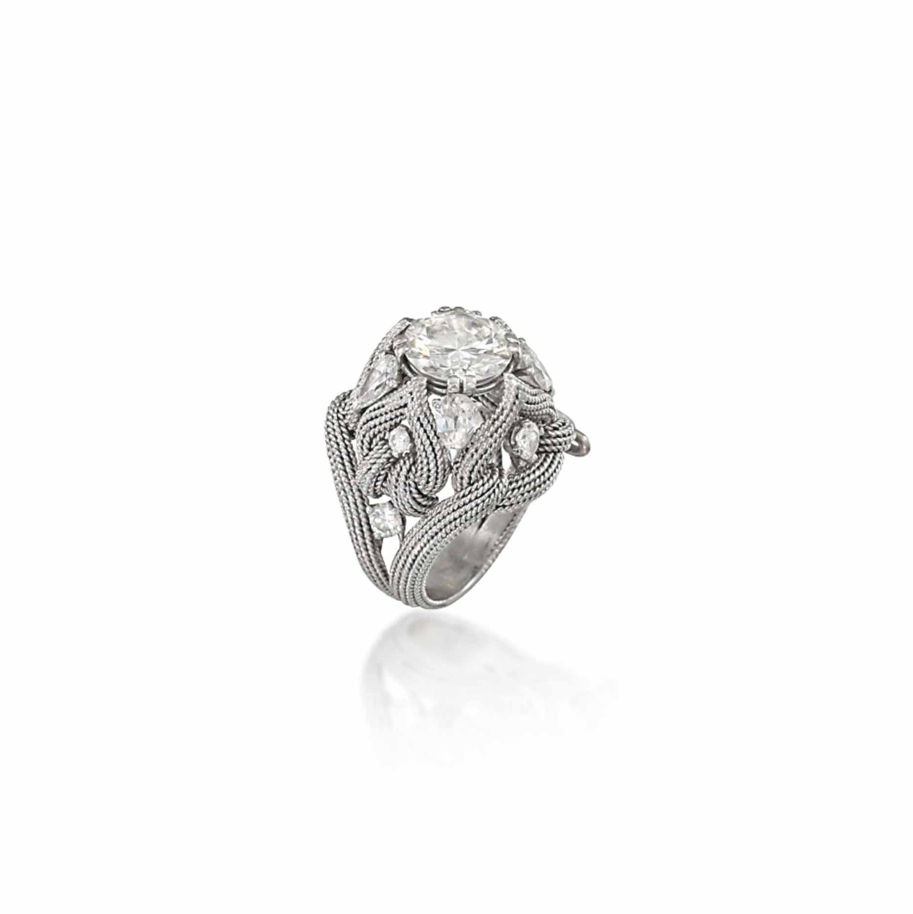 A DIAMOND-SET DRESS RING, BY STERLÉ