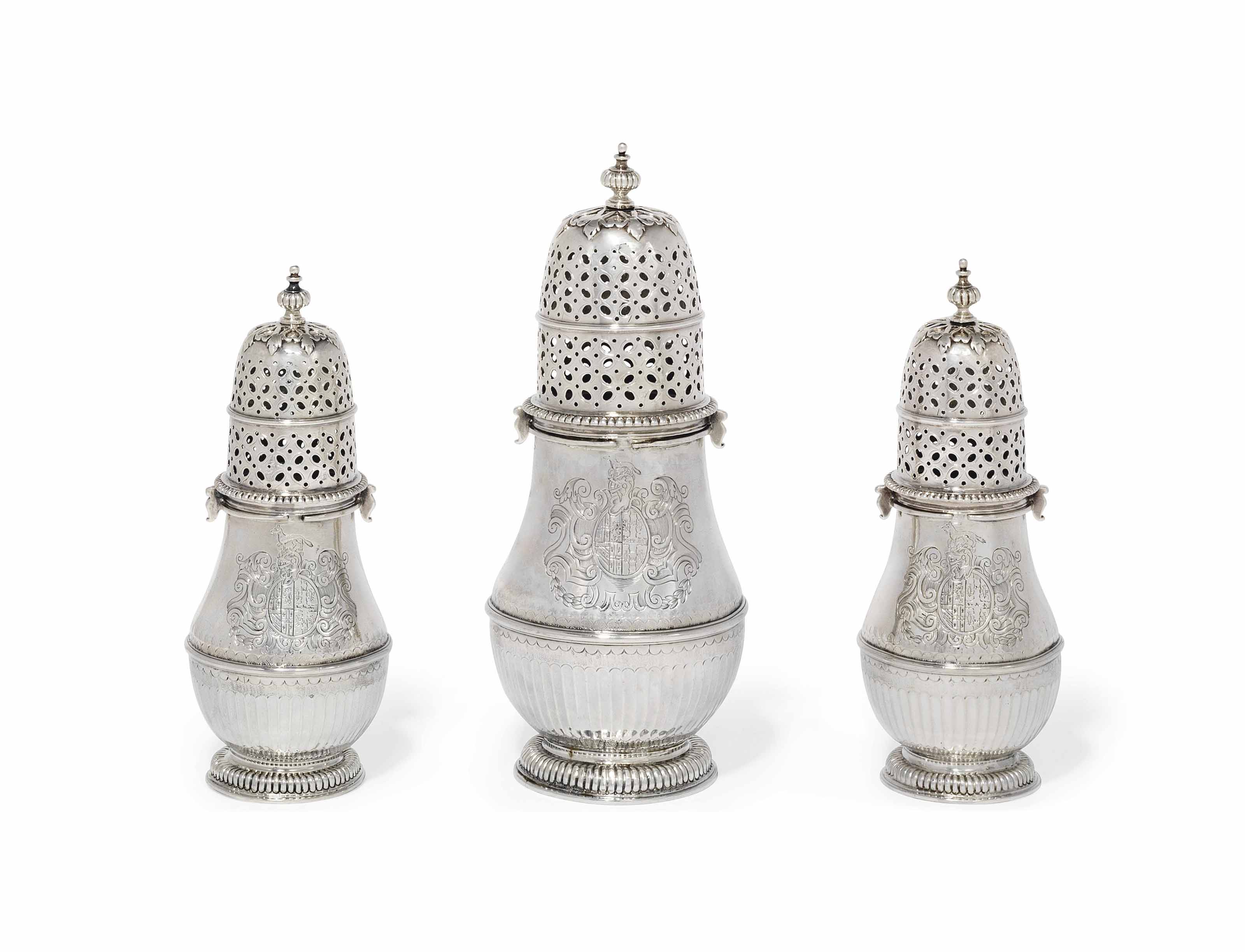 A SET OF THREE QUEEN ANNE SILVER CASTERS