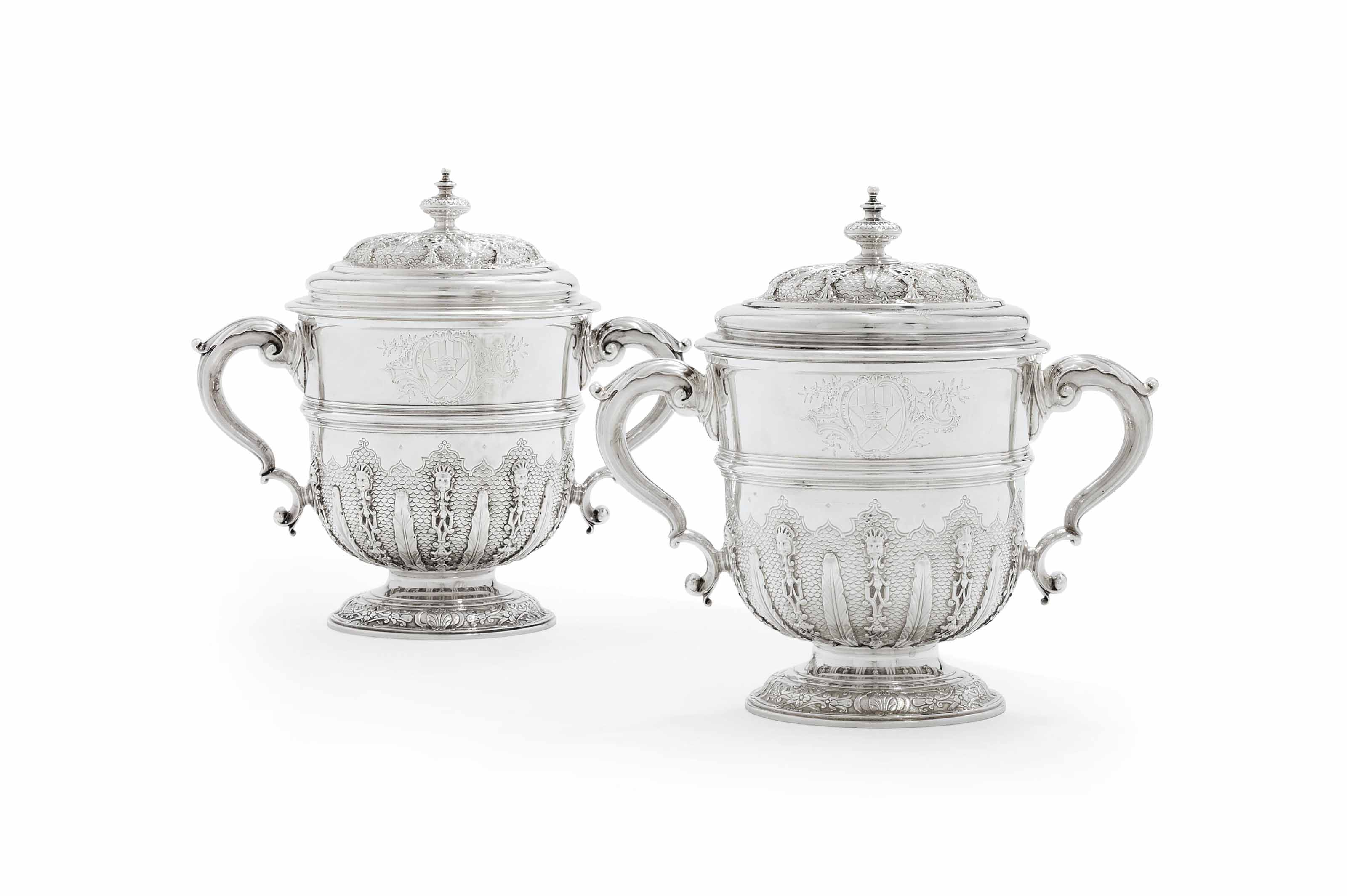 A PAIR OF GEORGE II SILVER CUPS AND COVERS