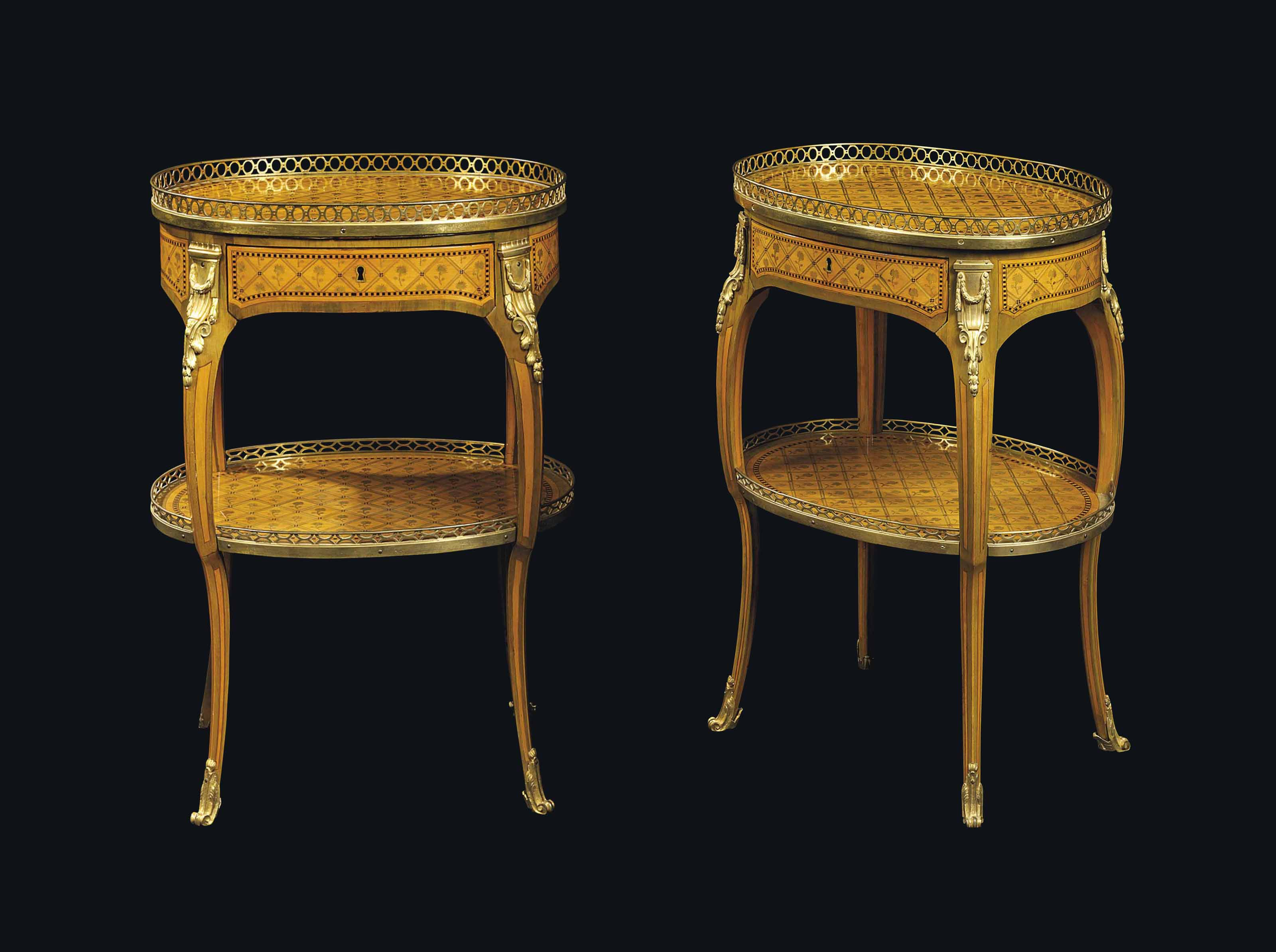 A NEAR PAIR OF LATE LOUIS XV ORMOLU-MOUNTED GREEN-STAINED SYCAMORE, HOLLY, EBONY AND MARQUETRY TABLES A ECRIRE