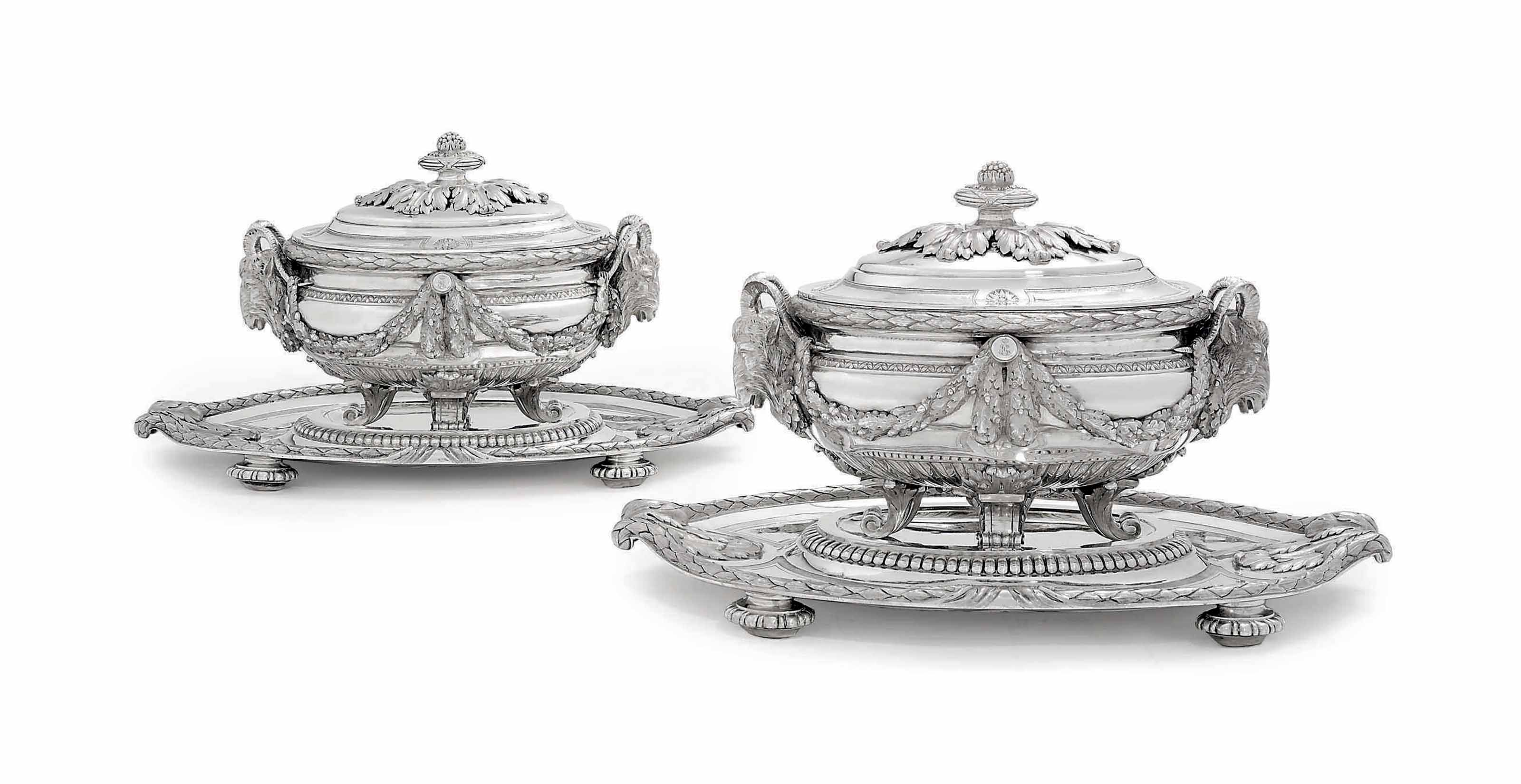 AN IMPORTANT PAIR OF LOUIS XVI SILVER SOUP-TUREENS, COVERS, STANDS AND LINERS