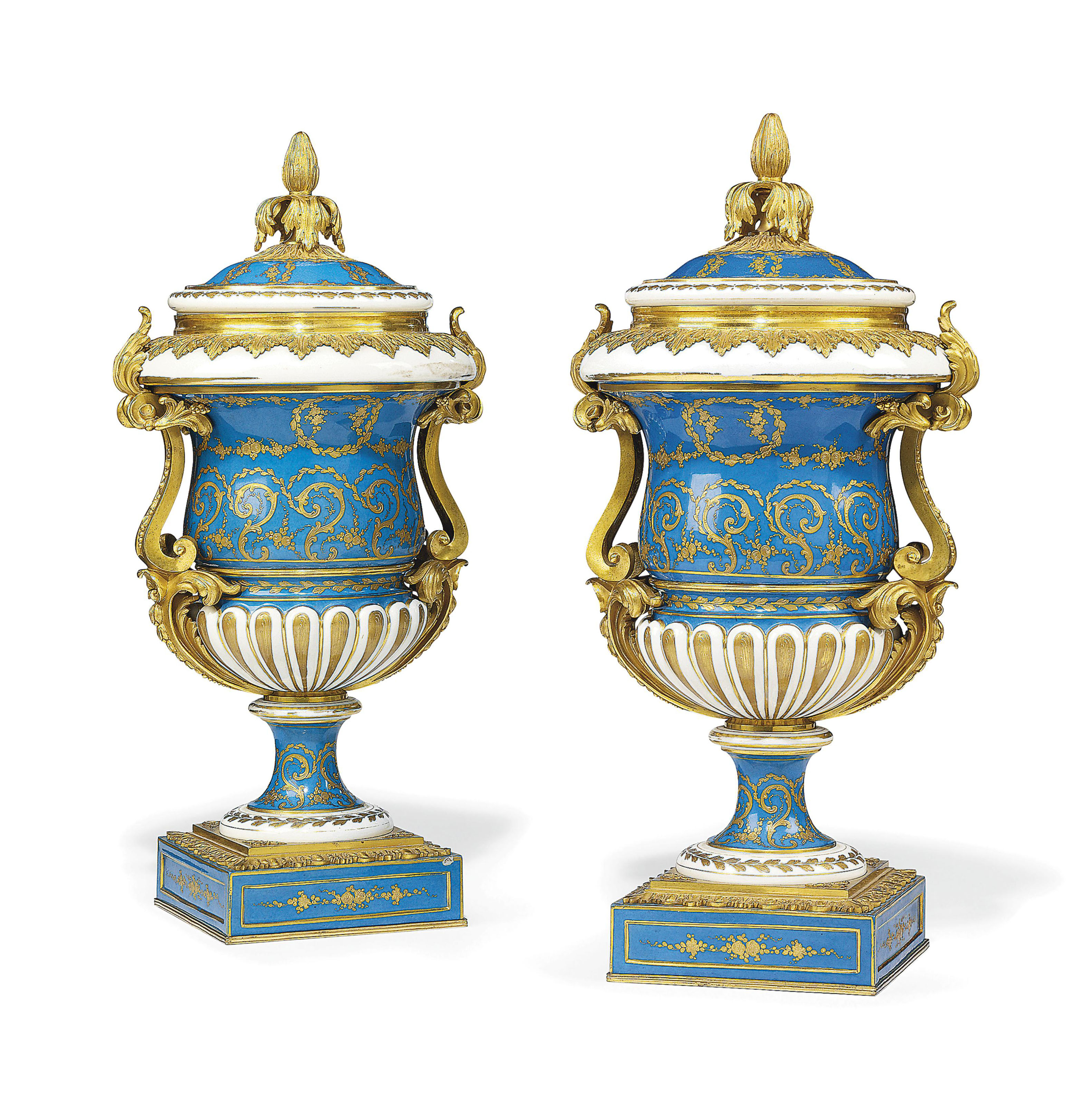 A PAIR OF FRENCH ORMOLU-MOUNTED SEVRES STYLE TURQUOISE GROUND VASES AND COVERS