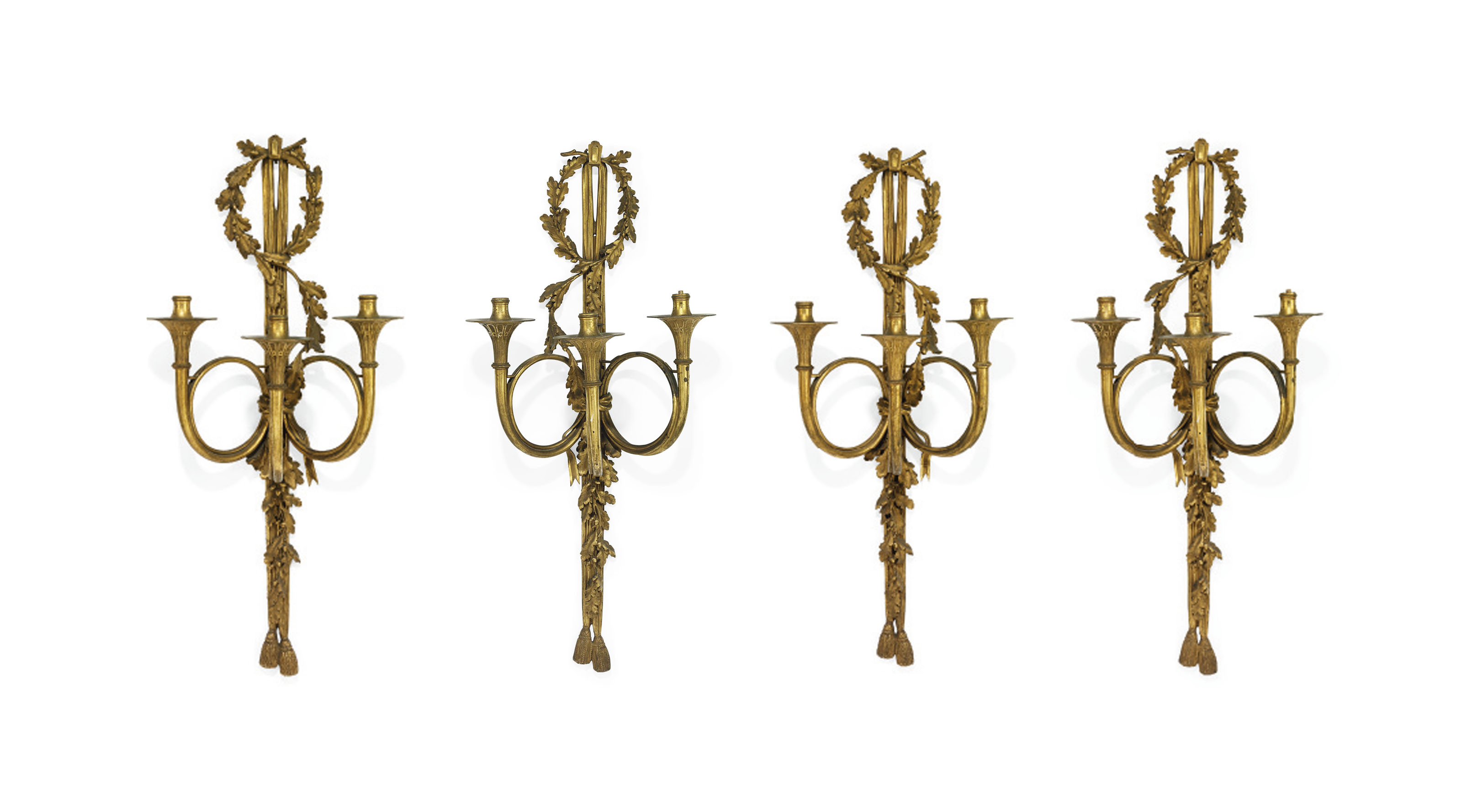 A SET OF FOUR FRENCH ORMOLU THREE-LIGHT WALL-APPLIQUES