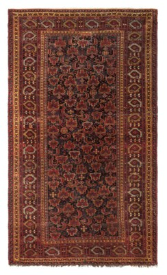 An antique Beshir large rug