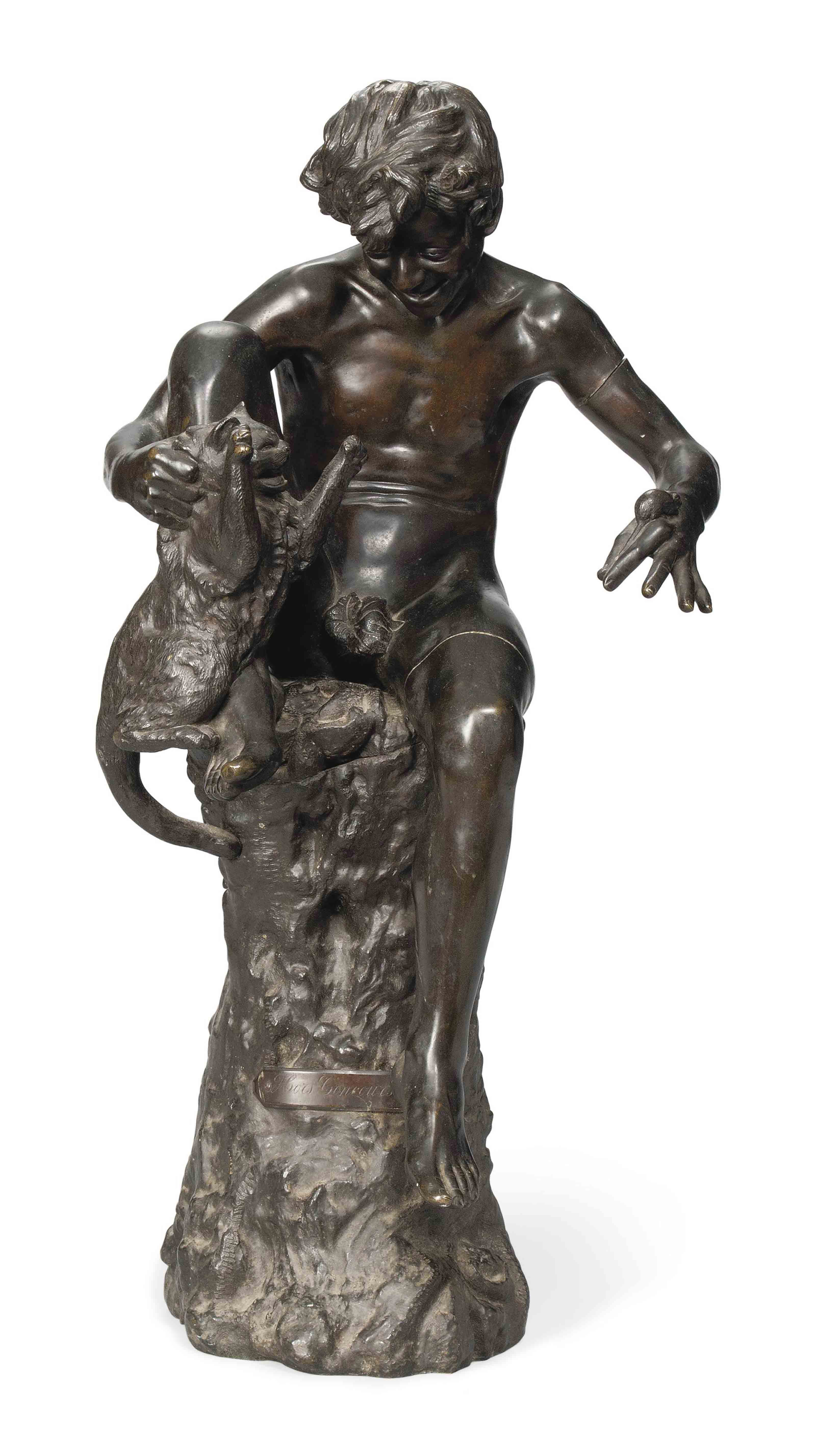 A BRONZE MODEL OF A BOY WITH A