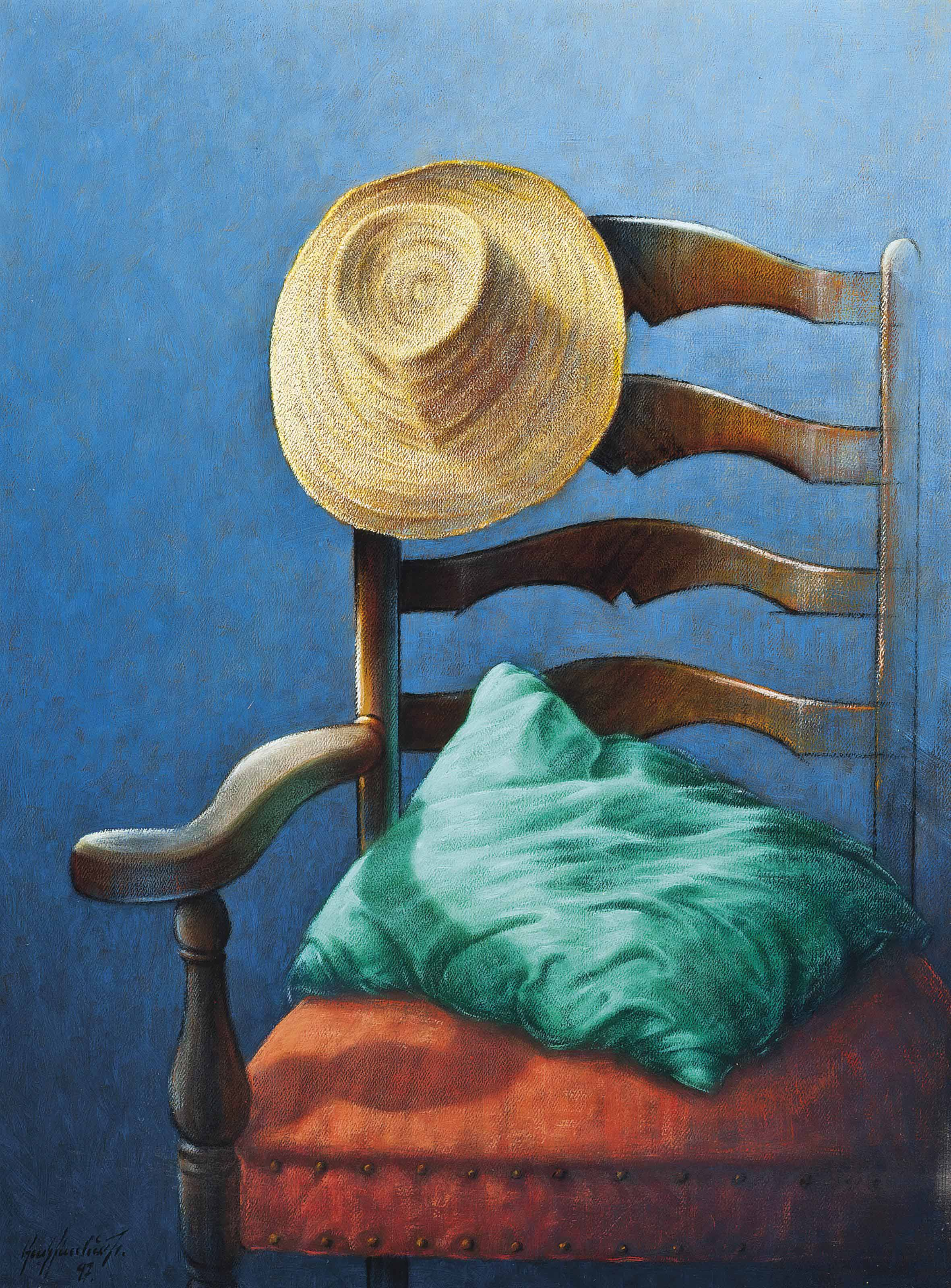 Straw hat and a cushion on a chair