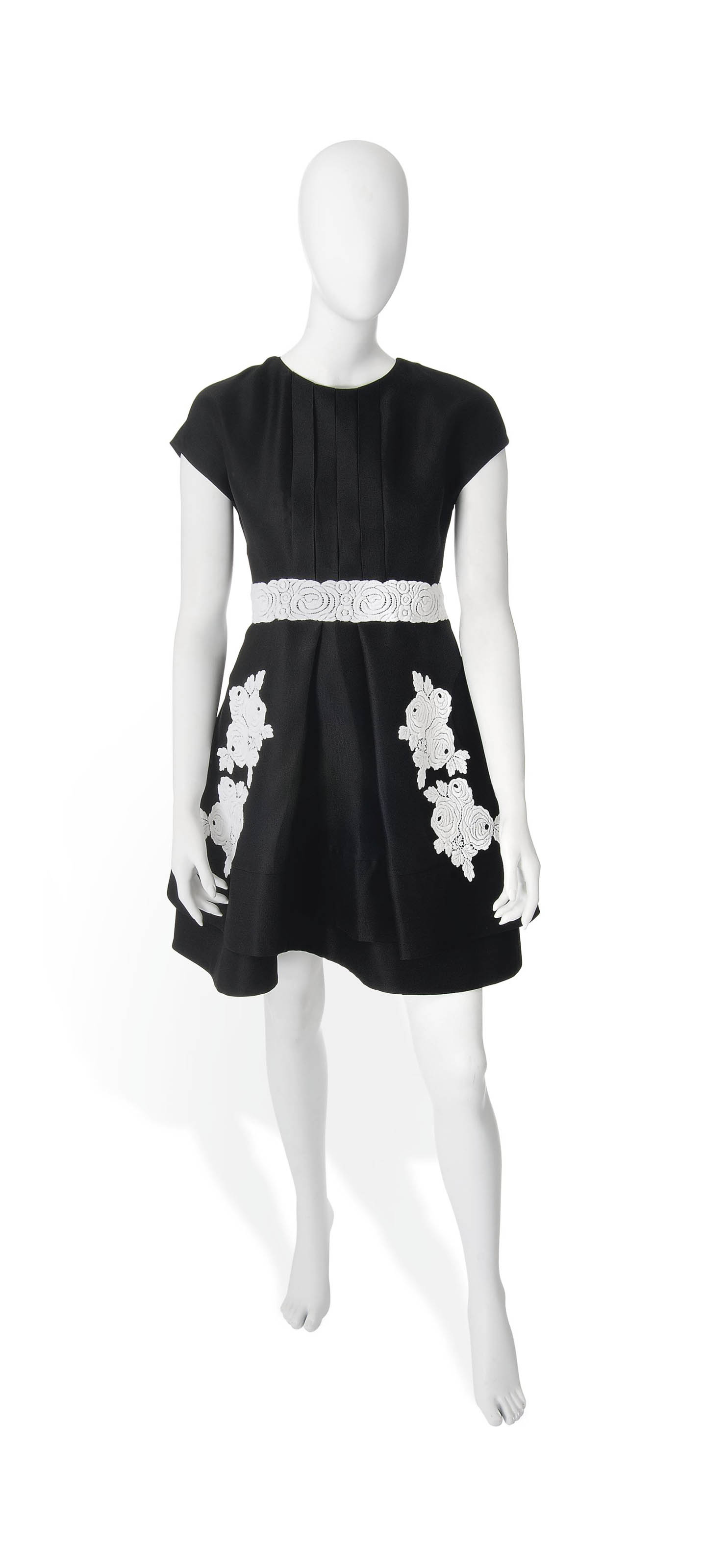 A Black Cocktail Dress With White Lace Guipure Flowers Requiem
