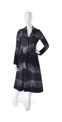 A THREE QUARTER LENGTH PURPLE AND SILVER EVENING COAT