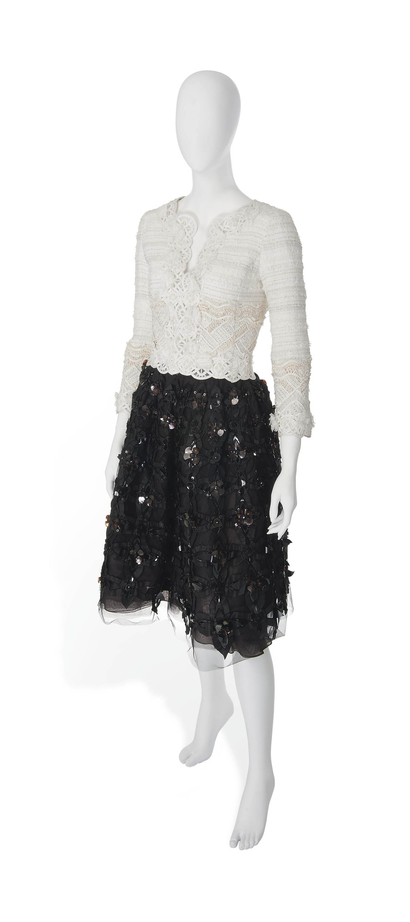 A CREAM BOUCLÉ TWEED SKIRT SUIT AND A BLACK EMBELLISHED TULLE SKIRT