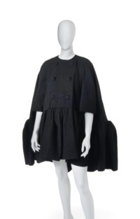 A TRAPEZE SHAPED BLACK SILK CLOQUÉ CAPE
