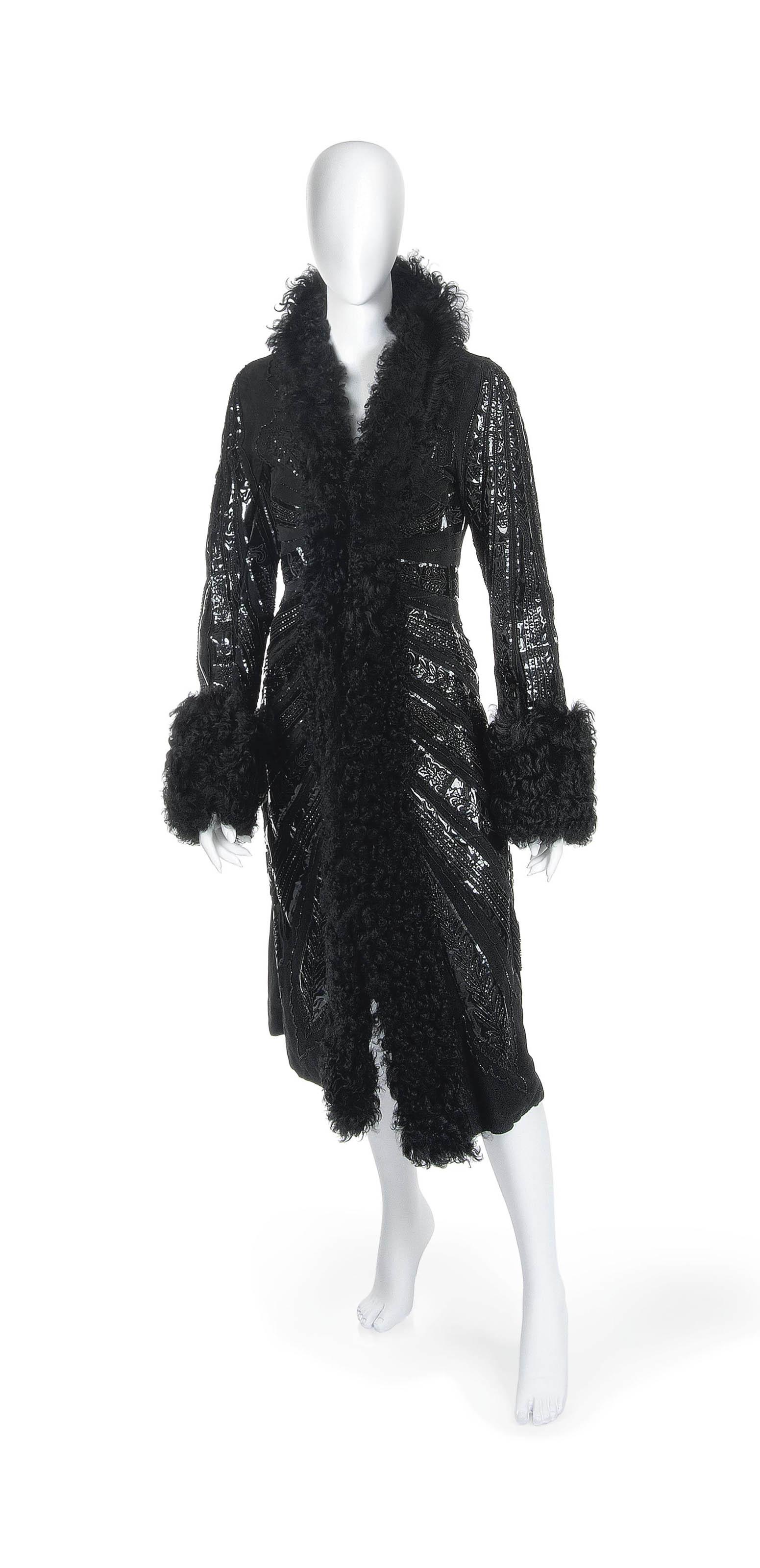 A FULL LENGTH BLACK SUEDE COAT WITH BLACK FUR TRIM