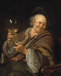 A man seated in an interior holding a roemer